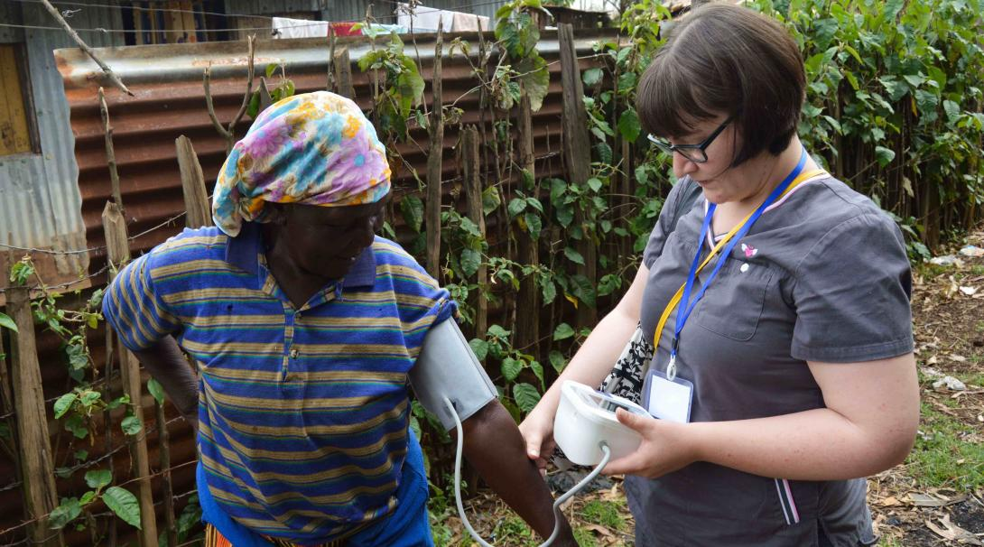 A Projects Abroad volunteer checks the blood pressure of a local woman in Kenya during her Nursing internship.